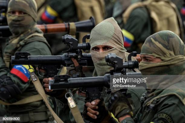 Venezuelan army soldiers carrying RPG antitank rockets participate in a military parade to celebrate Venezuela's 206th anniversary of its...