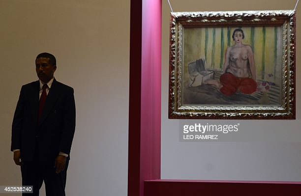 Venezuelan authorities stand guard next to Henri Matisse's painting 'Odalisque in Red Pants' during its reinauguration at the Contemporany Art Museum...