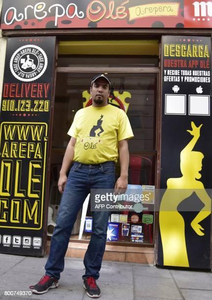 Venezuelan businessman Edgar Rodriguez poses outside his restaurant called 'Arepa Ole' in Madrid on June 14 2017 Edgar Rodriguez landed in Madrid ten...