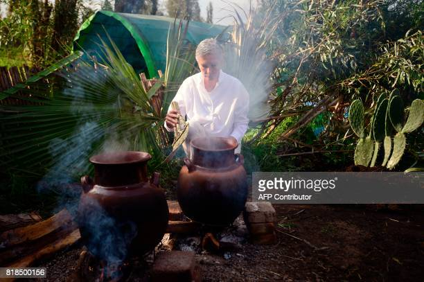 Venezuelan chef Maria Fernanda Di Giacobbe cooks during a symposium on biodiversity and gastronomy amid the floating gardens of Xochimilco a UNESCO...