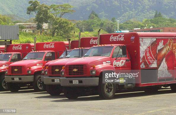 Venezuelan CocaCola Company delivery trucks stand idle in a parking lot of the closed San Cristobal production facilities January 11 2003 in the...