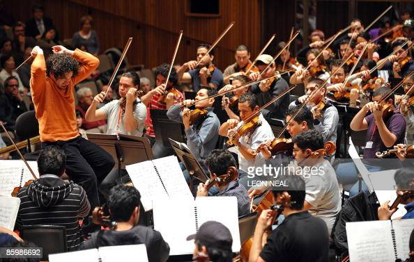 Venezuelan conductor Gustavo Dudamel instructs the Simon Bolivar Youth Orchestra during a rehearsal session at the Royal Festival Hall in central...