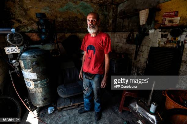 Venezuelan Cristobal Ramirez who supports President Nicolas Maduro despite the crisis poses during an interview with AFP in Barrio Union a...