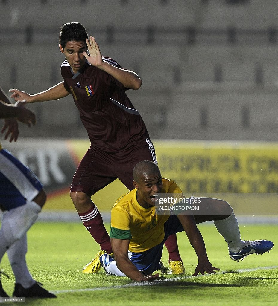 Venezuelan defender Victor Sifontes (L) fouls Brazilian midfielder Lucas Candido during their South American U-20 Championship Group B qualifier football match, at the Bicentenario stadium in San Juan, Argentina, on January 16, 2013. Four South American teams will qualify for the FIFA U-20 World Cup Turkey 2013. AFP PHOTO / ALEJANDRO PAGNI