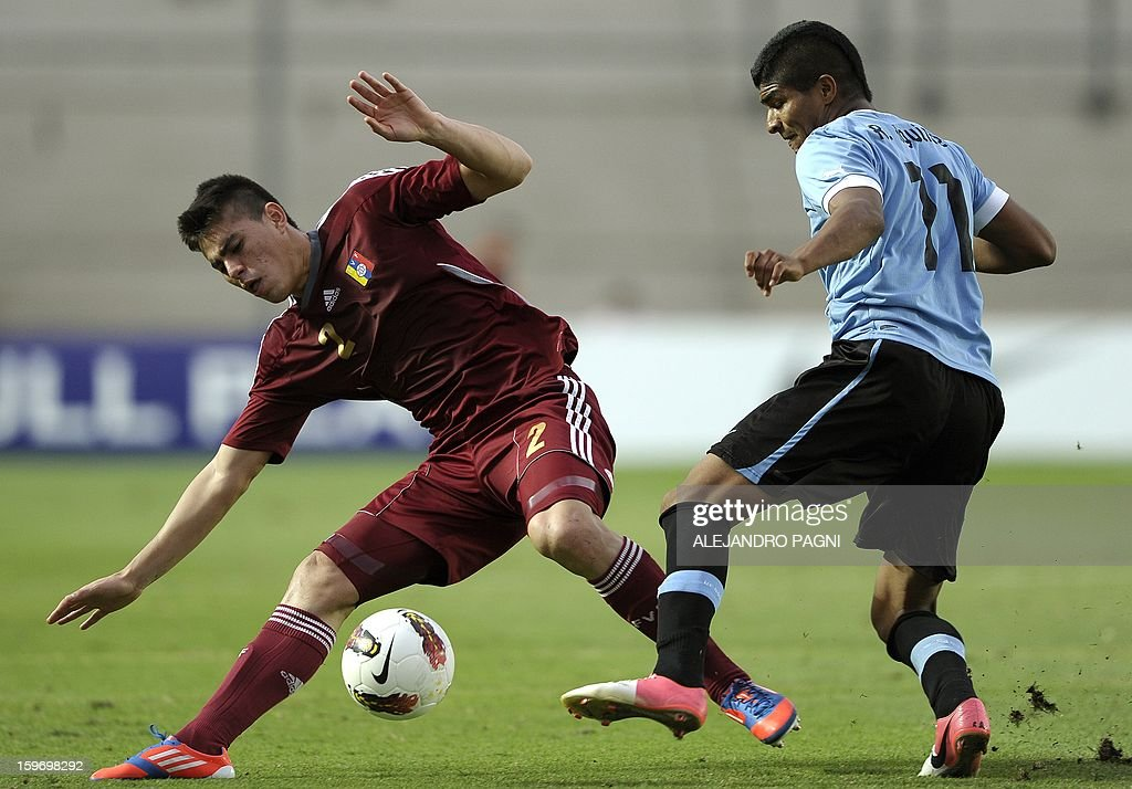 Venezuelan defender Wilker Angel (L) vies with Uruguayan midfielder Rodrigo Aguirre during the South American U-20 Group B football match at Bicentenario stadium in San Juan, Argentina, on January 18, 2013. Four teams will qualify for the Turkey 2013 FIFA U-20 World Cup.