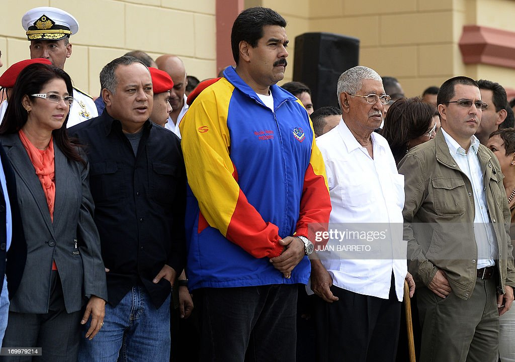 Venezuelan Firts Lady Cilia Flores ,Venezuela's National Assemby President Diosdado Cabello, Venezuelan President Nicolas Maduro, Hugo Chavez'sfather Hugo de los Reyes Chavez and Vice-President Jorge Arreaza attend a ceremony three months after Hugo Chavez's death, at the Cuartel de la Montana in Caracas, on June 05, 2013. AFP PHOTO