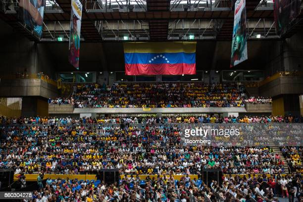 A Venezuelan flag hangs above attendees during an event marking Henrique Capriles opposition leader and governor of the State of Miranda last day as...