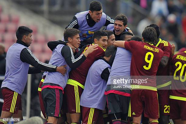 Venezuelan footballers celebrate after scoring against Colombia during their South American Championship U20 football match at the Olimpico Atahualpa...