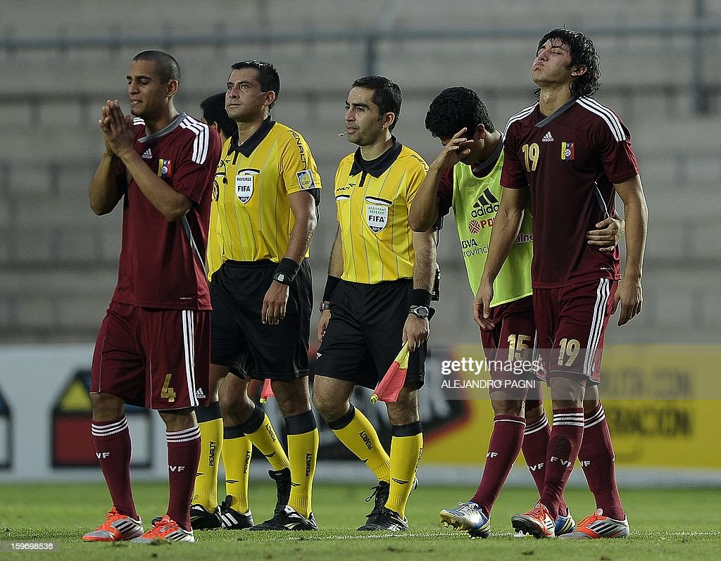 Venezuelan footballers react in dejection at the end of their South American U-20 Championship Group B football match against Uruguay, at Bicentenario stadium in San Juan, Argentina, on January 18, 2013. Four teams will qualify for the Turkey 2013 FIFA U-20 World Cup.