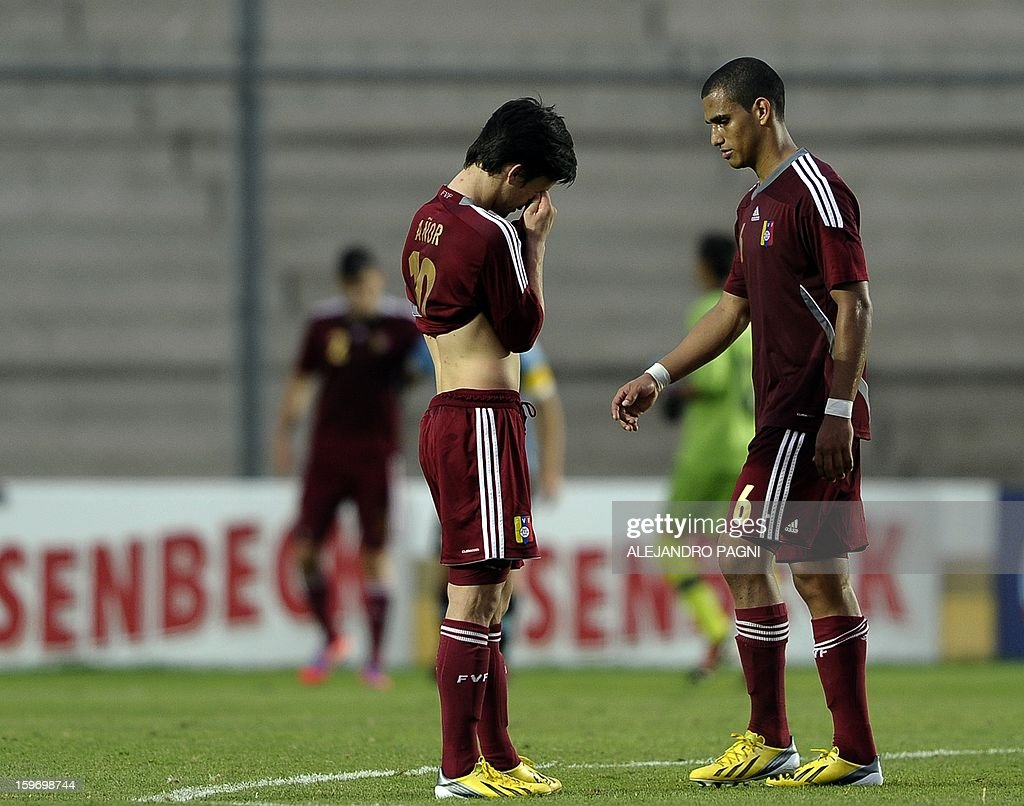 Venezuelan footballers show their dejection at the end of their South American U-20 Championship Group B football match against Uruguay, at Bicentenario stadium in San Juan, Argentina, on January 18, 2013. Four teams will qualify for the Turkey 2013 FIFA U-20 World Cup.