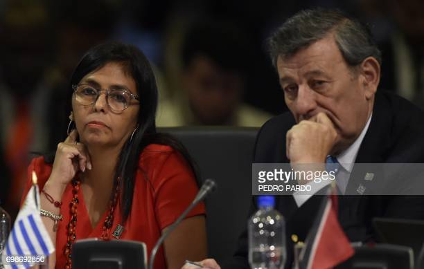 Venezuelan Foreign Minister Delcy Rodriguez and Uruguay's Foreign Minister Rodolfo Nin Novoa attend the OAS 47th General Assembly in Cancun Mexico on...