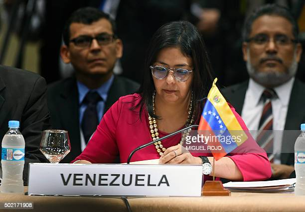 Venezuelan Foreign Minister Delcy Rodriguez checks documents befor ethe start of the 49th Mercosur Summit at the Conmebol headquarters in Luque on...