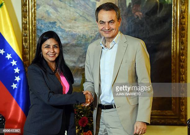 Venezuelan Foreign Minister Delcy Rodriguez shakes hands with former Spanish Prime Minister Jose Luis Rodriguez Zapatero during a meeting in Caracas...
