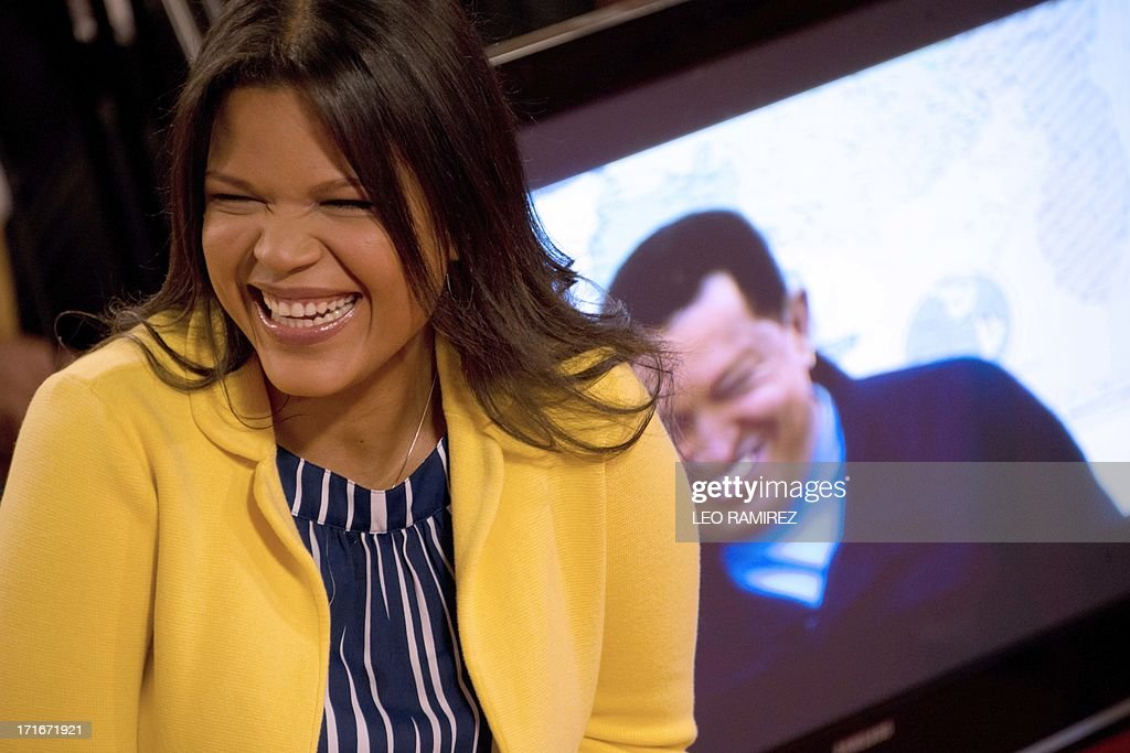 Venezuelan former President Hugo Chavez's daugther, Maria Gabriela, reacts as the National Journalist Award is posthumously granted to her late father, at the Miraflores presidential palace in Caracas on June 27, 2013. AFP PHOTO/Leo RAMIREZ