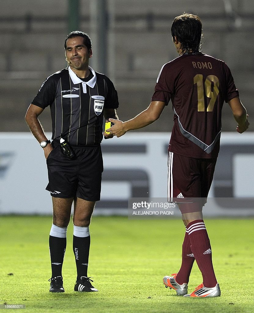 Venezuelan forward Jose Romo (R) complains to Bolivian referee Raul Orosco before Brazil's penalty kick during their South American U-20 Championship Group B qualifier football match, at the Bicentenario stadium in San Juan, Argentina, on January 16, 2013. Four South American teams will qualify for the FIFA U-20 World Cup Turkey 2013. AFP PHOTO / ALEJANDRO PAGNI