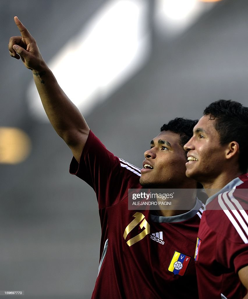 Venezuelan forward Josef Martinez (L) and midfielder Robert Garces celebrate after teammate Juan Anor (not in picture) scored the team's second goal against Uruguay during the South American U-20 Group B football match at Bicentenario stadium in San Juan, Argentina, on January 18, 2013. Four teams will qualify for the Turkey 2013 FIFA U-20 World Cup.