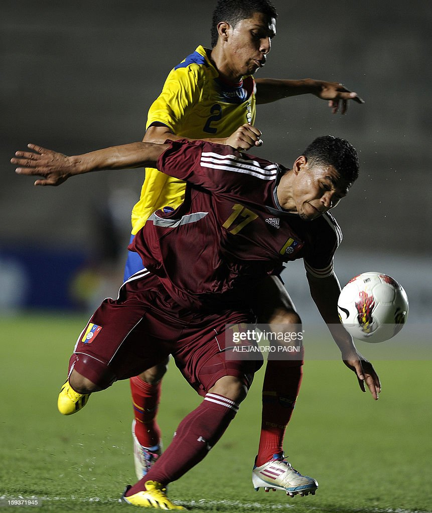 Venezuelan forward Josef Martinez (front) fights for the ball with Ecuadorean defender Luis Leon during their South American U-20 Championship Group B football match at Bicentenario stadium in San Juan on January 12, 2013. Four South American teams will qualify for the FIFA U-20 World Cup Turkey 2013.