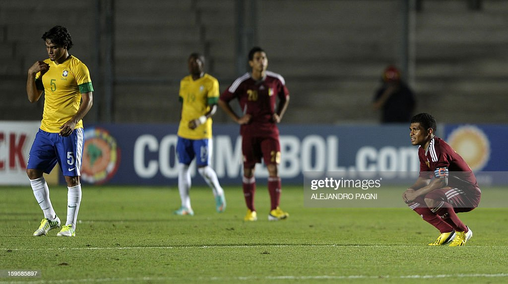 Venezuelan forward Josef Martinez (R) reacts in dejection after losing in their South American U-20 Championship Group B qualifier football match against Brazil, at the Bicentenario stadium in San Juan, Argentina, on January 16, 2013. Four South American teams will qualify for the FIFA U-20 World Cup Turkey 2013.