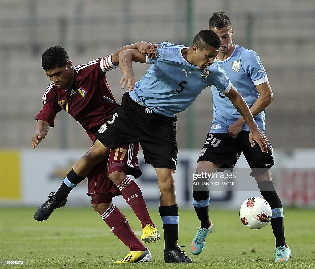 Venezuelan forward Josef Martinez (L) vies for the ball with Uruguayan midfielder Jim Varela during the South American U-20 Group B football match at Bicentenario stadium in San Juan, Argentina, on January 18, 2013. Four teams will qualify for the Turkey 2013 FIFA U-20 World Cup.