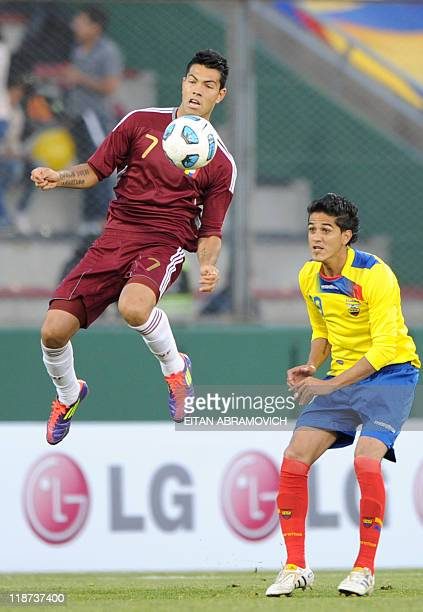 Venezuelan forward Nicolas Fedor is marked by Ecuadorean defender Norberto Araujo during a 2011 Copa America Group B first round football match held...