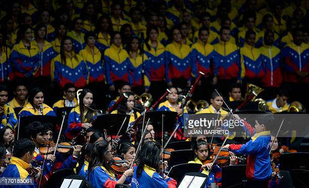 Venezuelan Jose Luis Alvaray a musician in the Simon Bolivar Youth Orchestra performs as director during a presentation at a ceremony in the city of...
