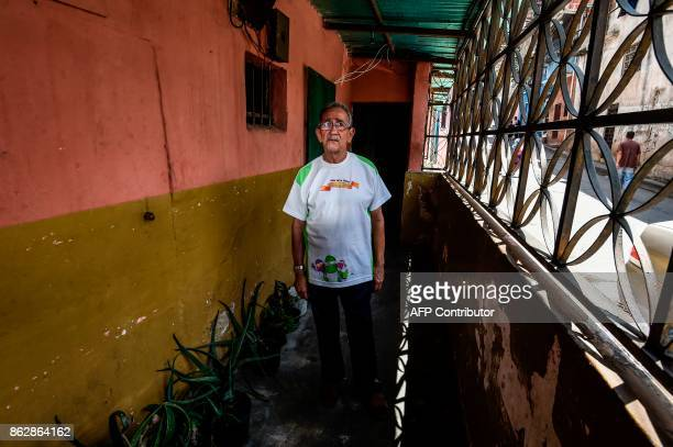 Venezuelan Jose Yanez who supports President Nicolas Maduro despite the crisis and eating once a day poses during an interview with AFP in Barrio...