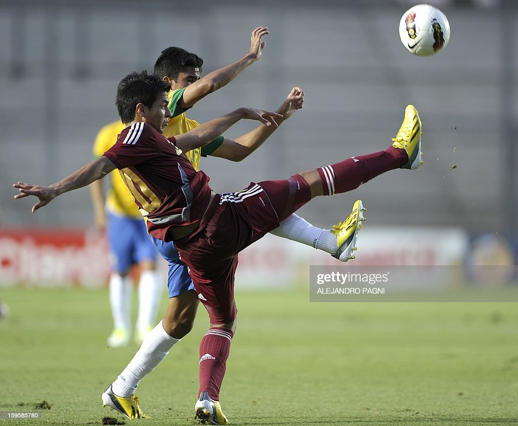 Venezuelan midfielder Renzo Zambrano (front) vies for the ball with Brazilian defender Igor Juliao during their South American U-20 Championship Group B qualifier football match, at the Bicentenario stadium in San Juan, Argentina, on January 16, 2013. Four South American teams will qualify for the FIFA U-20 World Cup Turkey 2013.