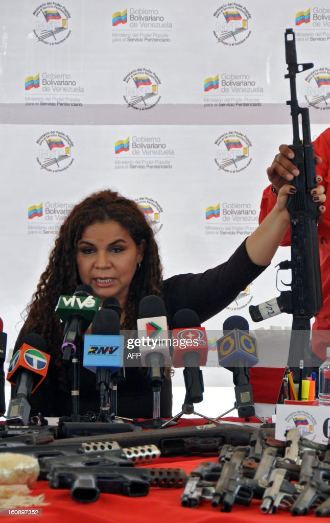 Venezuelan Minister of Correctional Services Iris Varela shows a rifle during a press conference in Barquisimeto, Venezuela on February 7, 2013. A total of 106 weapons, including rifles and submachine guns, 8568 ammunitions and a dozen grenades were seized by Venezuelan authorities after the eviction of Uribana prison in Lara state (northwest), where 58 people were killed during a riot two weeks ago. AFP PHOTO/Dedwinson Alvarez