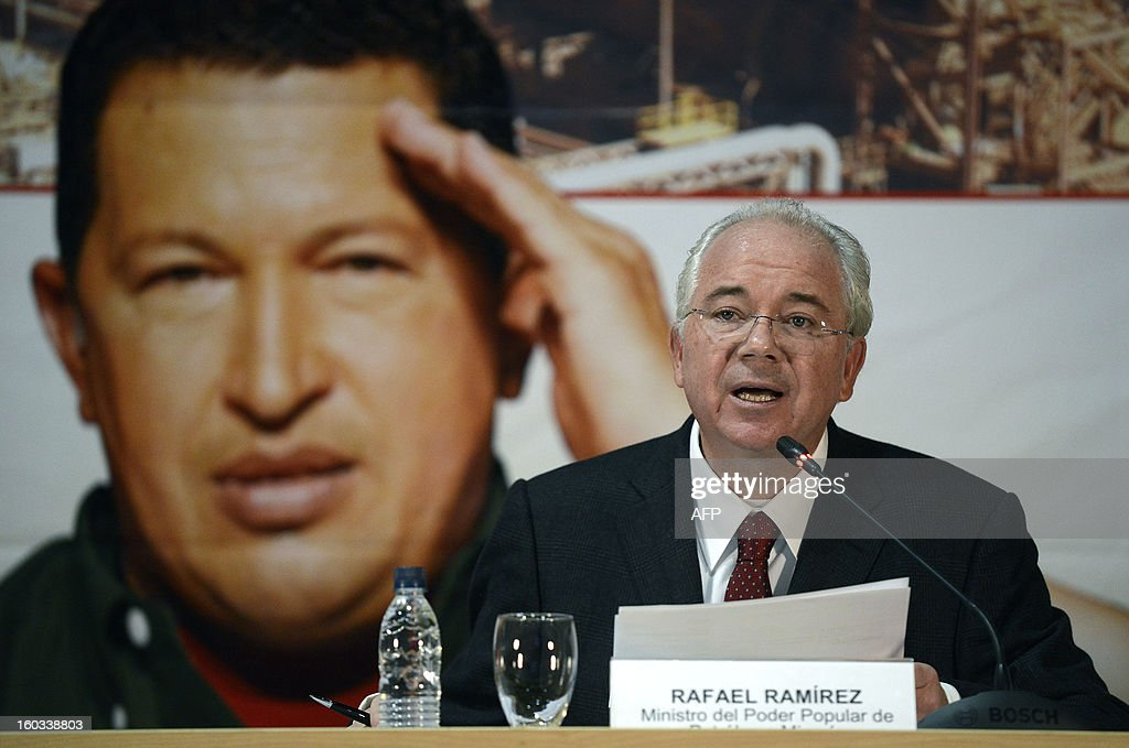 Venezuelan Minister of Oil and Mining and president of state-owned oil company PDVSA Rafael Ramirez speaks during a meeting with the the CEO of Russian state-owned oil company ROSNEFT, Igor Ivanovich Sechin (out of frame) to evaluate the development of joint projects in the area of energy and hydrocarbons, in Caracas on January 29, 2013. AFP PHOTO/ Leo RAMIREZ