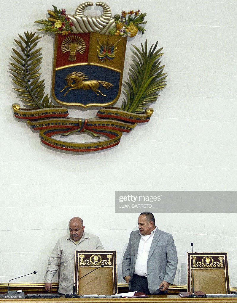 Venezuelan National Assembly president, Diosdado Cabello (R), and Vice-President Dario Vivas arrive to a session in Caracas on January 8, 2013. Cabello announced on January 8, 2013, that due to health reasons, Venezuelan President Hugo Chavez will not be able to take the oath to be sworn in for a fourth term in office next January 10. AFP PHOTO/JUAN BARRETO