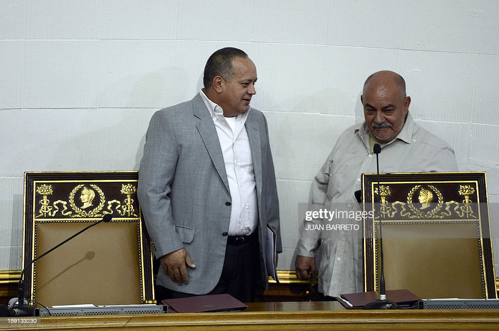 Venezuelan National Assembly president, Diosdado Cabello (L), and Vice-President Dario Vivas arrive to a session in Caracas on January 8, 2013. Cabello announced on January 8, 2013, that due to health reasons, Venezuelan President Hugo Chavez will not be able to take the oath to be sworn in for a fourth term in office next January 10.