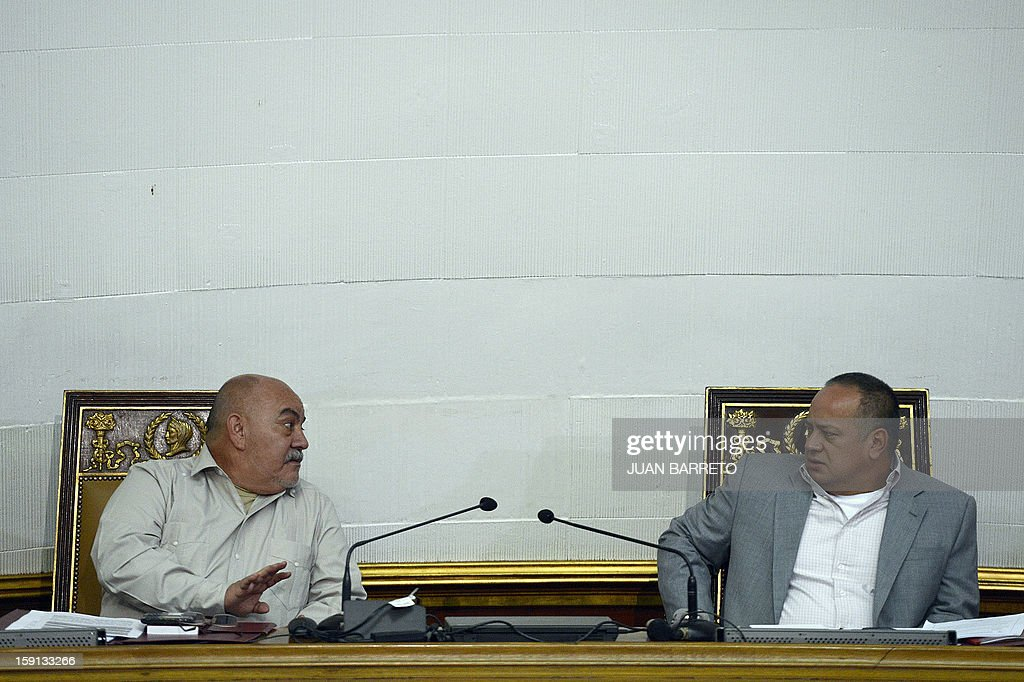 Venezuelan National Assembly president, Diosdado Cabello (R), and Vice-President Dario Vivas are seen during a session in Caracas on January 8, 2013. Cabello announced on January 8, 2013, that due to health reasons, Venezuelan President Hugo Chavez will not be able to take the oath to be sworn in for a fourth term in office next January 10. AFP PHOTO/JUAN BARRETO
