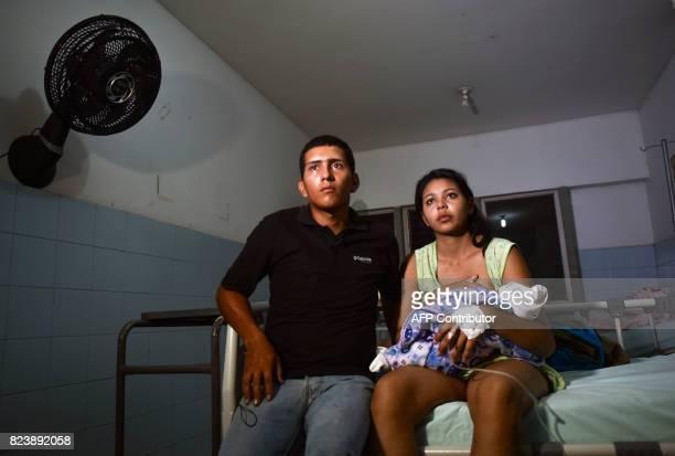 Venezuelan national Brecia Triago breastfeeds her newborn next to her husband Jose Luis Gonzales at the Erasmo Meoz University Hospital in Cucuta...