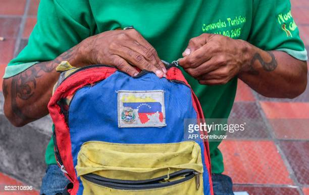 A Venezuelan national closes his bag as he waits to get food and shelter in front of the Migration Center in Cucuta North of the Santander department...
