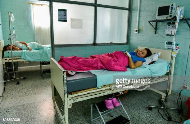 Venezuelan nationals Dayana Zambrano and Joselis Canas rest as they wait for their due date at the Erasmo Meoz University Hospital in Cucuta North of...