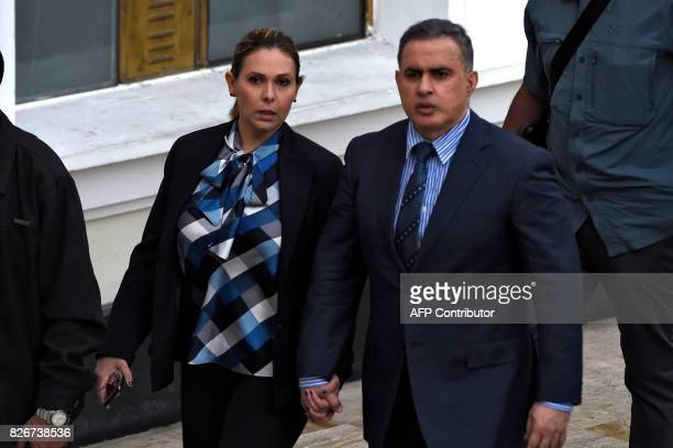 Venezuelan new Attorney General Tarek William Saab arrives with his wife Carla Di Martino for his swearing in ceremony before the Constituent...