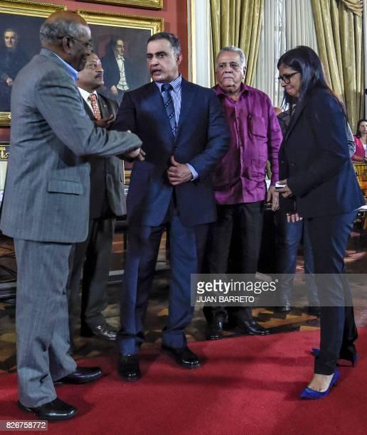 Venezuelan new Attorney General Tarek William Saab shakes hands with first VicePresident Aristobulo Isturiz next to the president of Venezuela's...