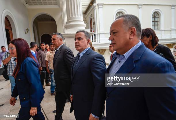 Venezuelan new Attorney General Tarek William Saab walks next to Constituent Assembly members Venezuelan First Lady Cilia Flores Pedro Carreno and...