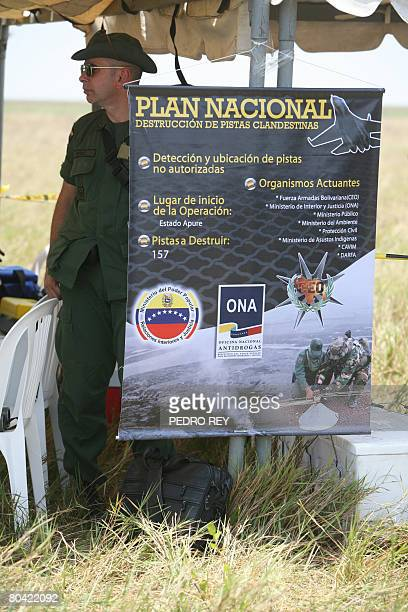 Venezuelan ONA and Army personnel explain to the press their objectives upon disembarking from helicopters to blow up a clandestine airstrip near...