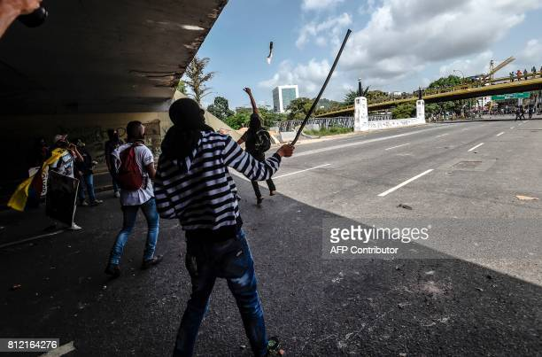 Venezuelan opposition activists clash with riot police during a protest against Venezuelan President Nicolas Maduro in Caracas on July 10 2017...