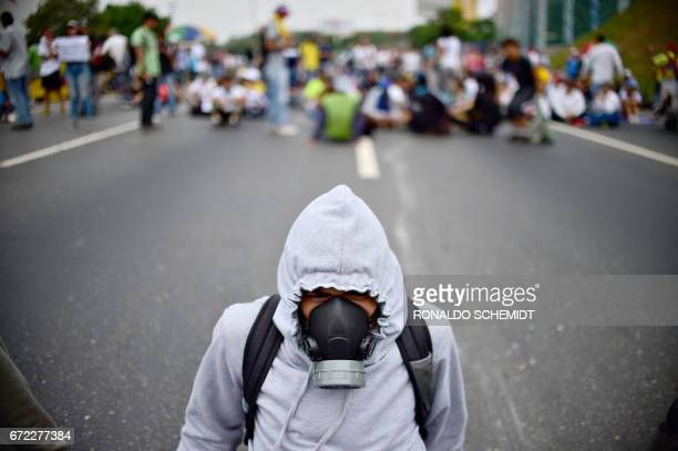 Venezuelan opposition activists organize a sitin to block the Francisco Fajardo motorway in Caracas on April 24 2017 Protesters plan Monday to block...