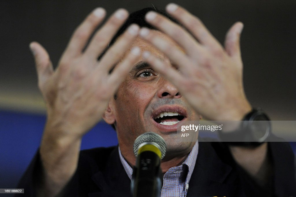 Venezuelan opposition candidate for the upcoming April 14 presidential election, Henrique Capriles, gestures during a press conference in Caracas on April 1, 2013. Capriles and interim President Nicolas Maduro -- the hand-picked successor of late president Hugo Chavez -- formally start campaigning for the April 14 presidential election on April 2. AFP PHOTO/Leo RAMIREZ