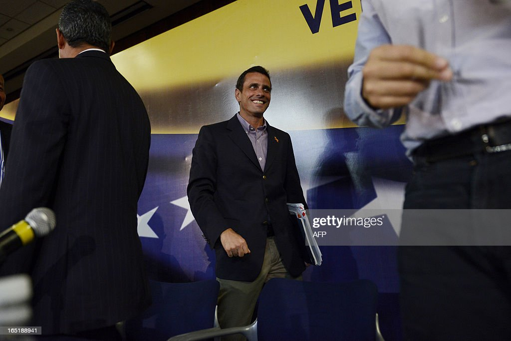 Venezuelan opposition candidate for the upcoming April 14 presidential election, Henrique Capriles, walks to take a seat before the start of a press conference in Caracas on April 1, 2013. Capriles and interim President Nicolas Maduro -- the hand-picked successor of late president Hugo Chavez -- formally start campaigning for the April 14 presidential election on April 2. AFP PHOTO/Leo RAMIREZ