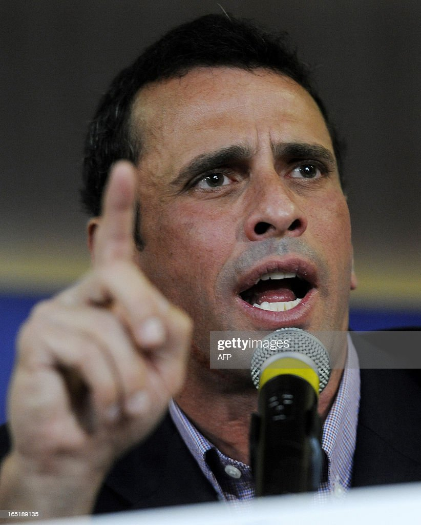 Venezuelan opposition candidate for the upcoming April 14 presidential election, Henrique Capriles, speaks during a press conference in Caracas on April 1, 2013. Capriles and interim President Nicolas Maduro -- the hand-picked successor of late president Hugo Chavez -- formally start campaigning for the April 14 presidential election on April 2. AFP PHOTO/Leo RAMIREZ