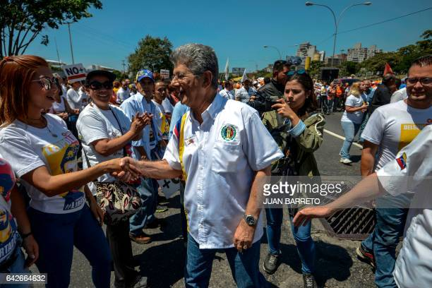 Venezuelan opposition lawmaker Henry Ramos Allup greets supporters of jailed opposition leader Leopoldo Lopez during a demonstration held on the...