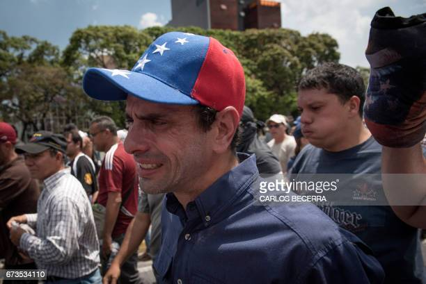 TOPSHOT Venezuelan opposition leader and former presidential candidate Henrique Capriles takes part in a protest against President Nicolas Maduro in...