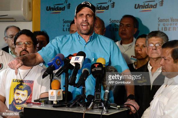 Venezuelan opposition leader and Miranda state governor Henrique Capriles and members of the opposition coalition Democratic Unity Roundtable offer a...