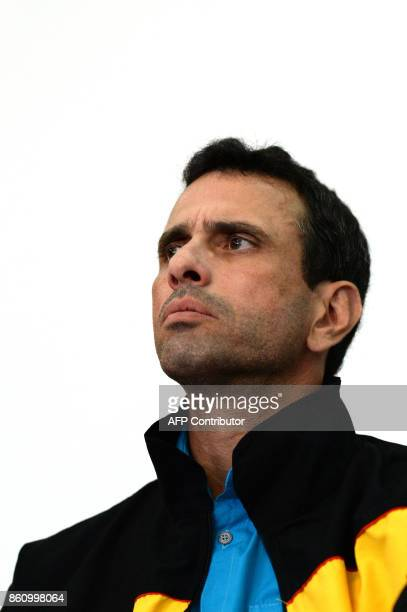 Venezuelan opposition leader Henrique Capriles and members of the opposition coalition Democratic Unity Roundtable offer a press conference in...