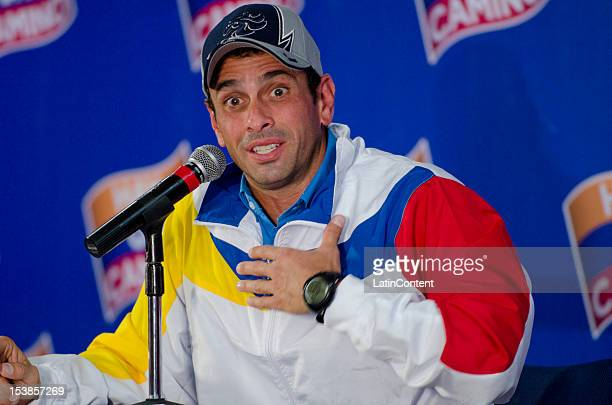Venezuelan opposition leader Henrique Capriles attends a press conference on October 09 2012 in Caracas Venezuela Capriles and Hugo Chavez ran for...