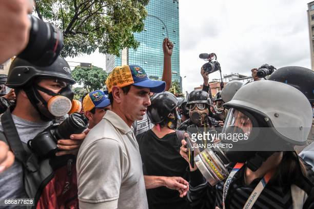 Venezuelan opposition leader Henrique Capriles attends a protest of doctors and other health care personnel in Caracas on May 22 2017 Doctors rallied...